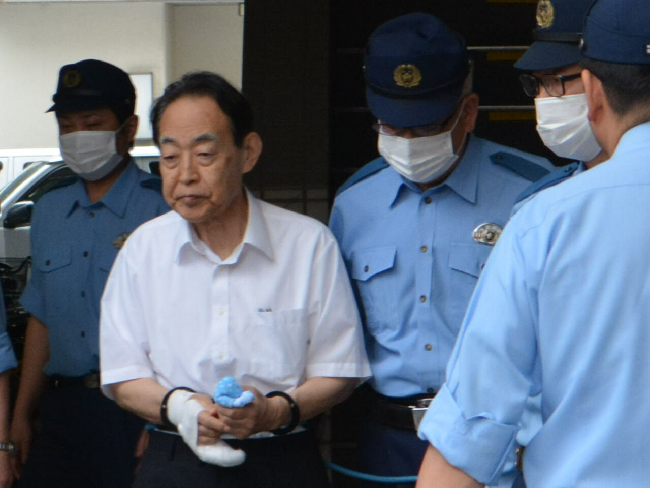被告 熊沢